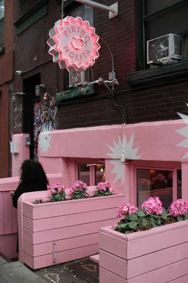 The exterior of Pietro Nolita reflects its pink interior. (via Flickr)