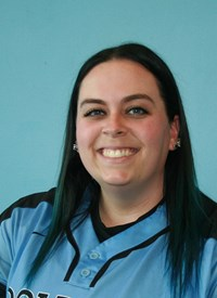 The NYU Women's softball team welcomed Alison, Meagher, a new assistant coach, this year. (Via NYU Athletics)