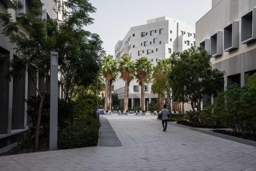 A student walks through the NYU Abu Dhabi Campus. NYU Abu Dhabi is planning to increase enrollment by 40%. (Photo by Sam Klein)