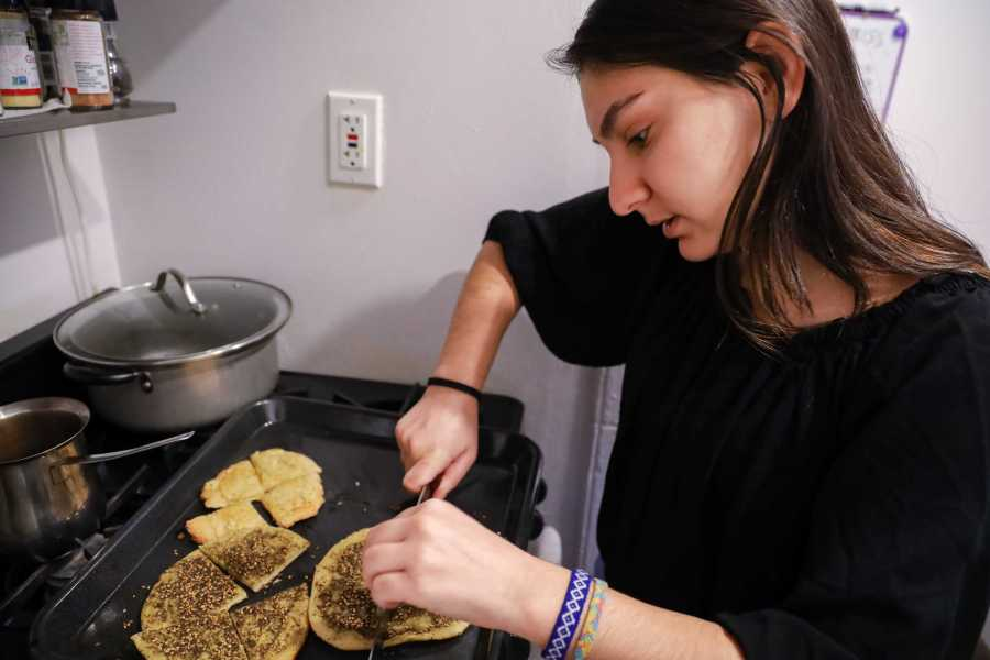 Maha serves her mother's homemade bread sprinkled with za'atar, a common Middle Eastern spice mixture. (Photo by Elaine Chen)