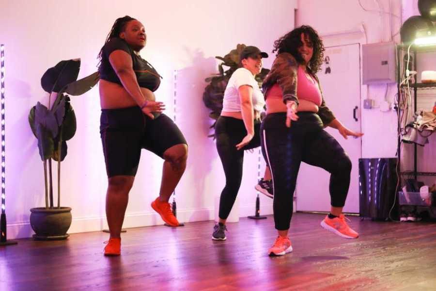 Jessie and returning students Keyiona Roulhac (left) and Michelle Colon (center) doing their final performance of the choreography they learned in this class for the song China by Puerto Rican rapper Anuel AA.
