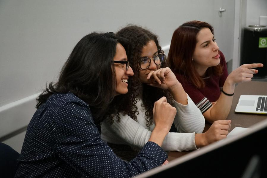 Carlos (left) and two other members of NYU Cabaret laugh after hearing an audition. Up until the beginning of last year, he wanted to be an actor and loves to perform. (Photo by Min Ji Kim)