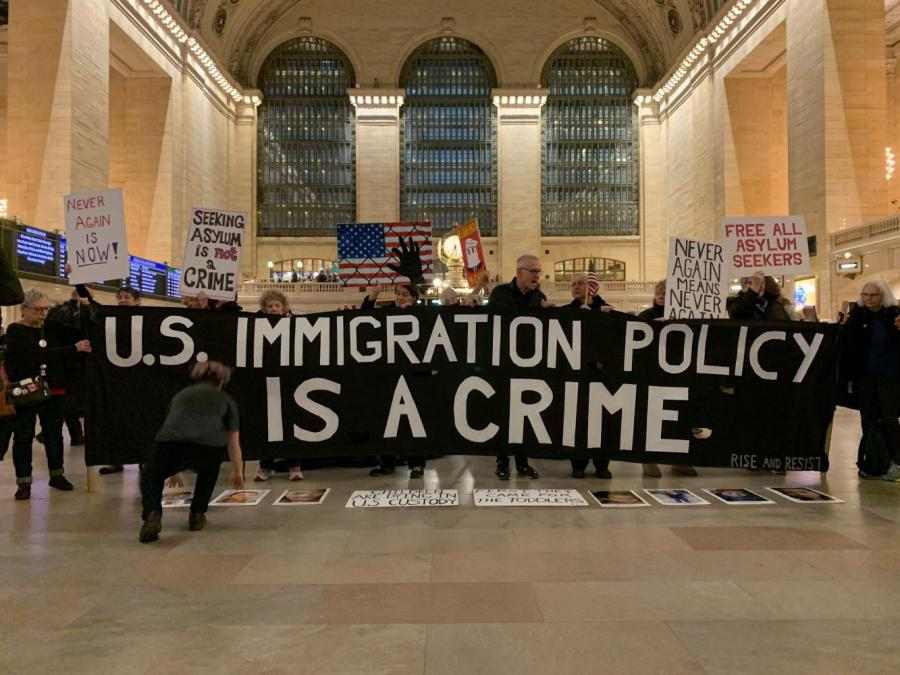 ICE protesters show off homemade banners in Grand Central demonstration.  (Staff photo by Mina Mohammadi)