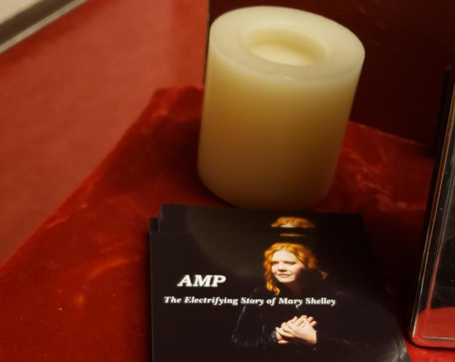 """Inspired by its Gothic source material, AMP sets the scene with eerie candlelight. Styled as """"The Electrifying Story of Mary Shelley,"""" the one-woman show spanned the author's life. (Photo by Dani Herrera)"""