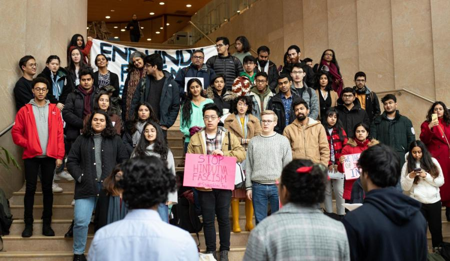 Signs and banners covered the steps at the Kimmel Center. Students stand in solidarity to end Fascism in Hindu communities. (Photo by AJ Nickell)