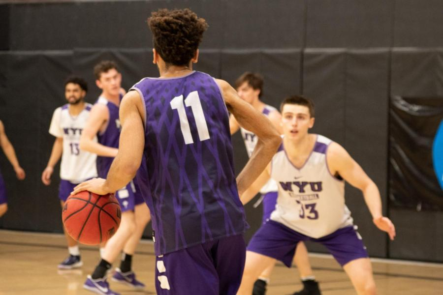 Tandon senior Riley Demps dribbles the ball, looking for a chance to pass during practice. The men's basketball team ended a tough but rewarding season. (Staff Photo by Jake Capriotti)