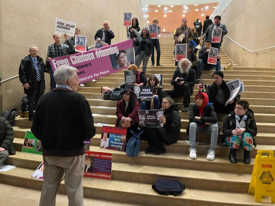 """A rally is held at the Kimmel Stairs by International Youth and Students and Students for Social Equality on 2020 Super Tuesday. """"Free Julian Assange, Free Chelsea Manning"""" rang from the Kimmel Stairs last night as Super Tuesday polling results rolled in. (Staff photo by Mina Mohammadi)"""