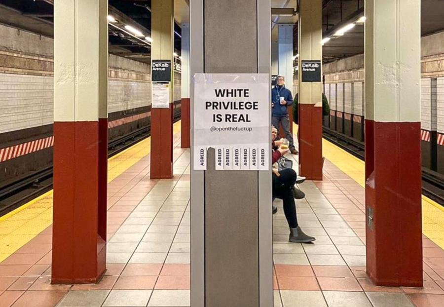 "A flyer bearing the statement, ""White Privilege is Real"" is tacked on a pole in the subway. These flyers have been put up all over the city by Open the F-ck Up, a new social experiment encouraging people to open up about taboo issues. (Image via Instagram @openthefup)"