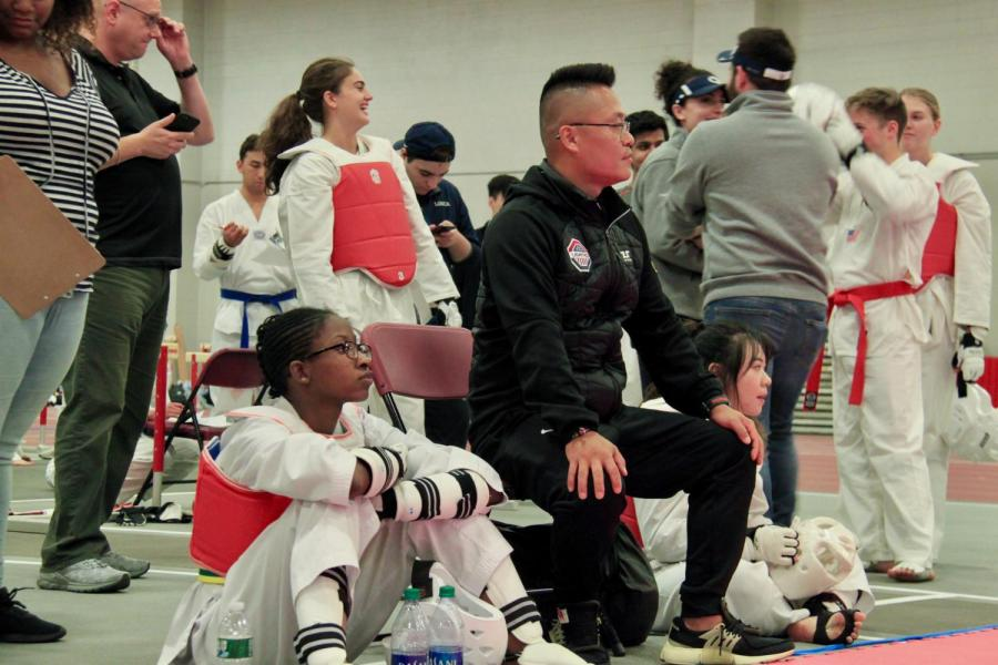 NYU Taekwondo team Coach Master Andrew Park watches the Women's C team spar at the MIT tournament earlier in October. (Staff Photo by Alexandra Chan)