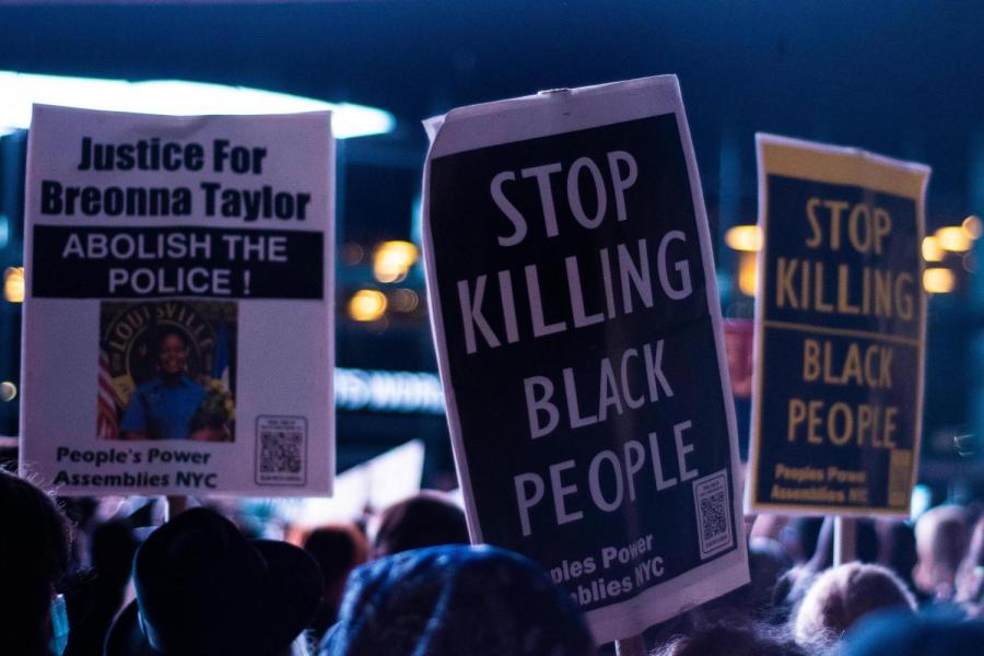 Protesters hold up signs calling for justice for Breonna Taylor at Barclays. (Staff Photo by Jake Capriotti)