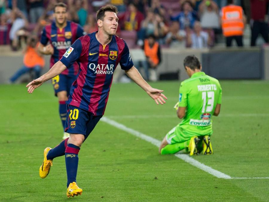 Lionel Messi celebrating a goal against Granada CF for Barcelona back in October of 2014. Now, Messi and the club's current relationship remains uncertain after the player's request to leave was denied. (Image via Wikimedia, from L.F.Salas)