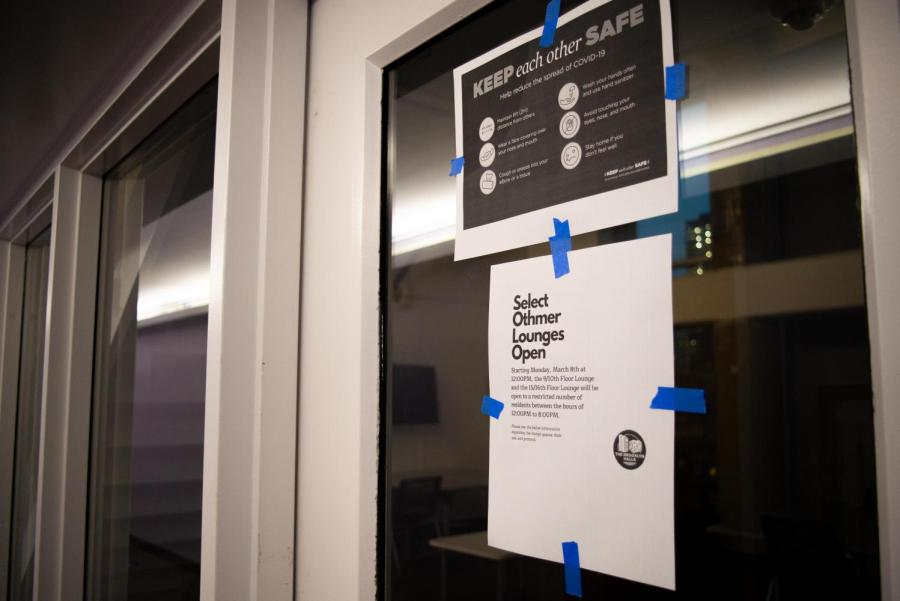 COVID policy signs are taped on the door of  Brooklyn dorm Othmer Hall's lounge. NYU dorm lounges are reopening across campus and many are worried about the increased risk of COVID-19 spread. (Staff Photo by Jake Capriotti)