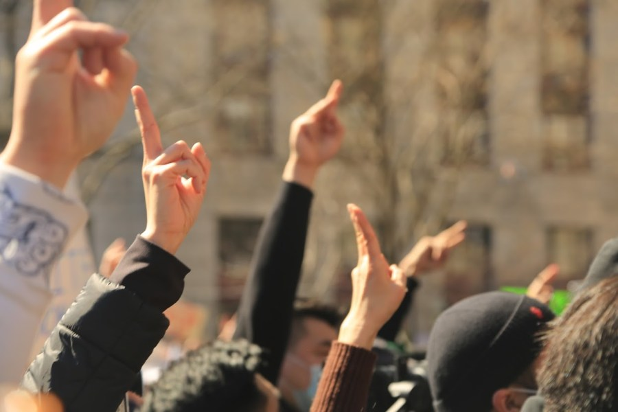 Protestors make peace signs with their hands during the rallies. (Photo by Suhail Gharaibeh)