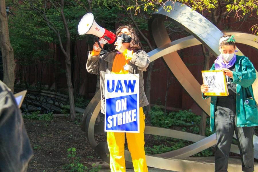 Picket line leader Tova amps up the crowd.