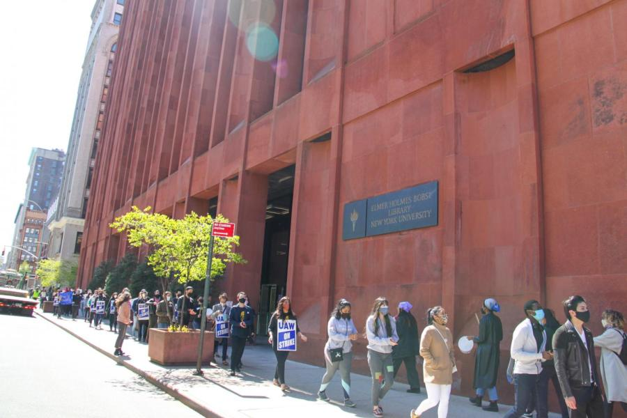 The picket line goes back and forth the front of Bobst Library.