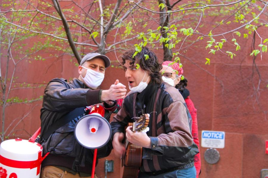 Picketers keep up the mood with songs.