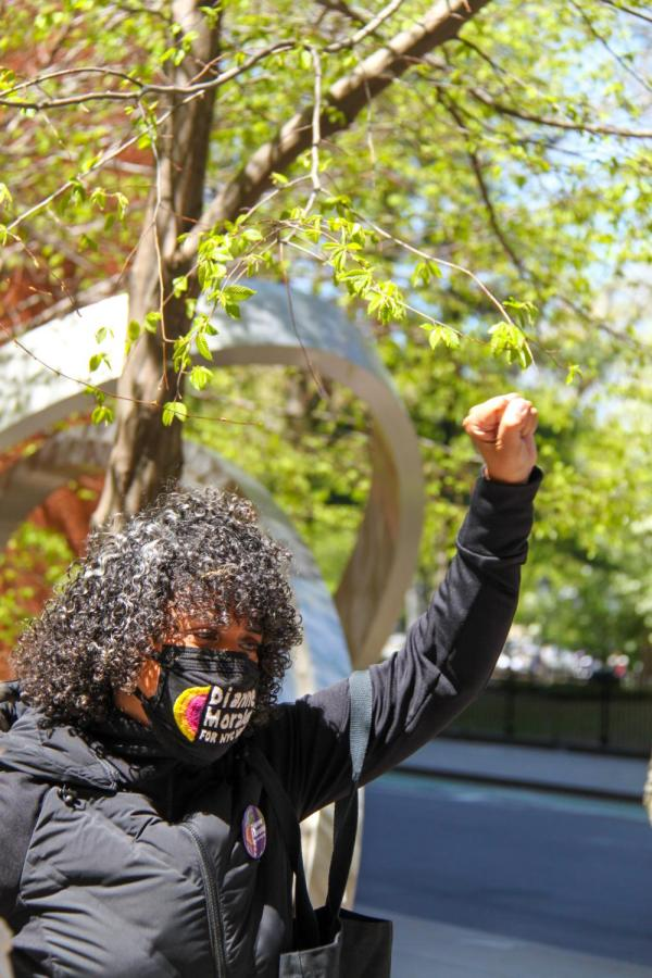 Dianne Morales raises her fist in solidarity with striking grad workers.