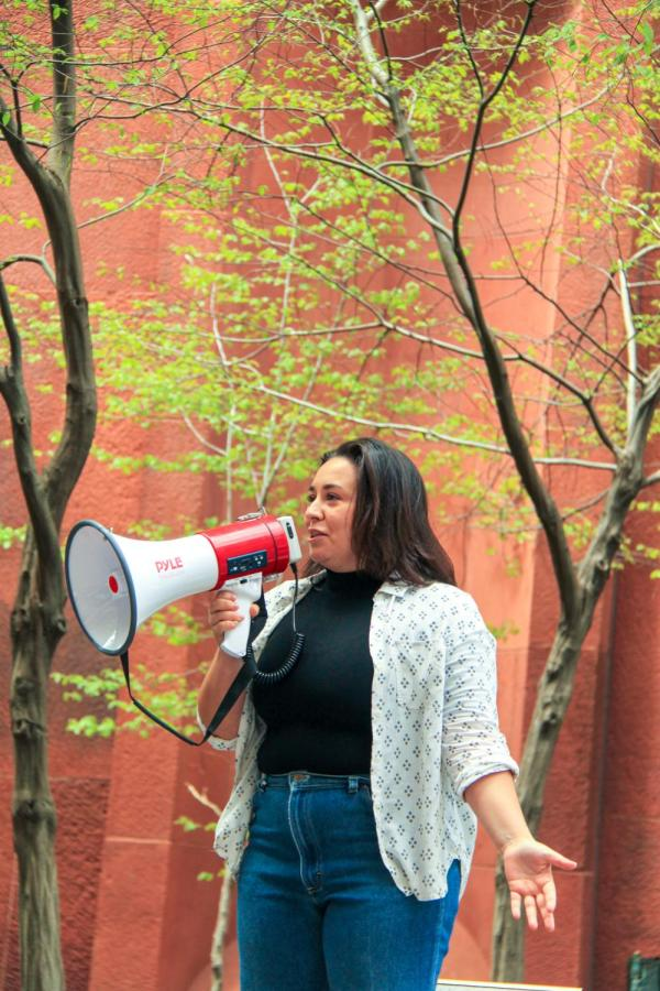 Comedians tell jokes to the crowd next to Bobst.