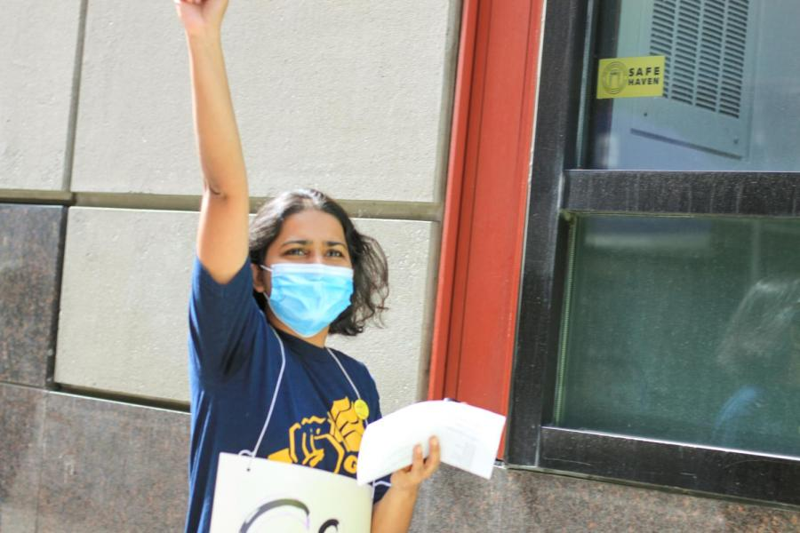 GSOC co-chair Bhumika raises her fist at the third day of GSOC's picket line.