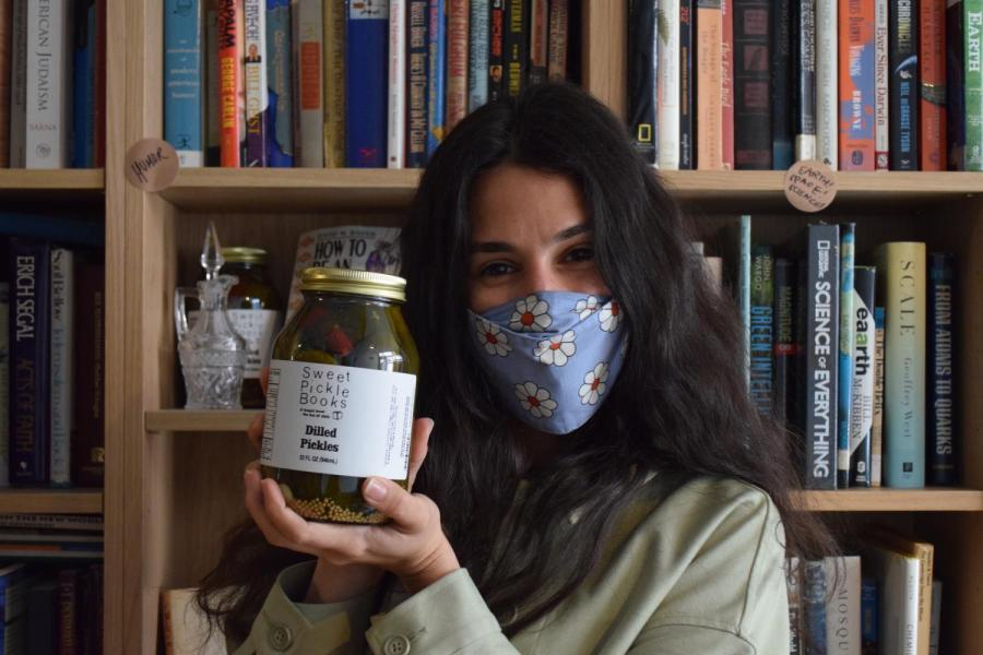 Leigh Altshuler opened Sweet Pickle Books, located on 47 Orchard St, in November of 2020. This Lower East Side small business is a used bookstore that also sells jars of pickles. (Staff Photo by Sabrina Choudhary)