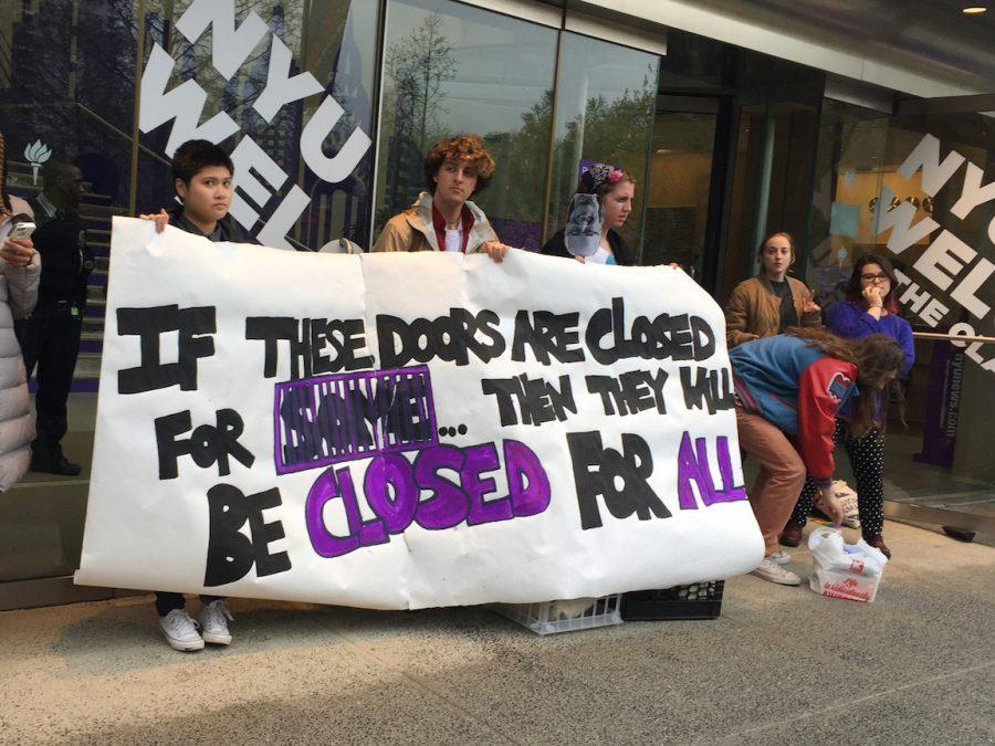 This is an image of NYU students' Incarceration to Education Coalition protest during 2017 Weekend on the Square. Since then, the university still has not shown coordinated effort dedicated to documenting its ties to chattel slavery, including the history of enslaved and more recently wrongly incarcerated people on campus grounds. (Photo by Natasha Roy)
