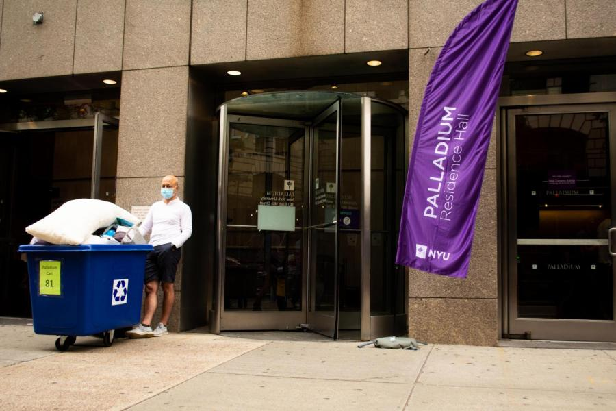 A parent stands outside Palladium Hall during move-in. NYU administration has introduced new procedures to allow for in-person operations during COVID-19. (Staff Photo by Jake Capriotti)