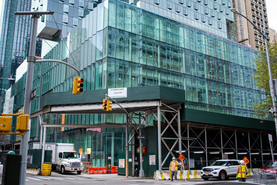 181 Mercer St., located between Bleecker and West Houston Streets, will be NYUs new multi-use building. NYU brands the building as sustainable, but the university's board still includes members who have ties to oil and gas companies. (Staff Photo by Manasa Gudavalli)