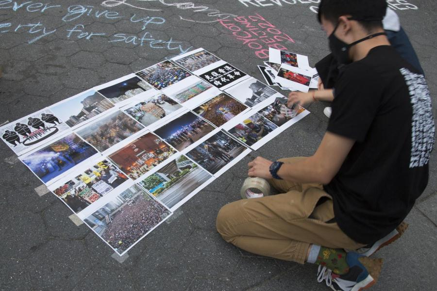 NYU's Hong Kong Student Advocacy Group displays artwork to spread awareness of the Chinese government's treatment of Hong Kong. The group organized a protest at Washington Square Park in solidarity with protesters in Hong Kong. (Photo by Thirdblade Photography)