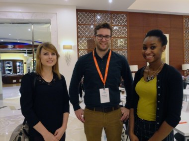 Marina Salamon and Alexandra Hightower shadow Alexander Cochran (center) at the Sharjah International Book Fair.