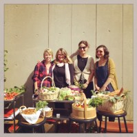 From left: Kitchen assistant Camille Shoemaker, Food Studies MA program director Jennifer Schiff Berg, food studies professor Amy Bentley, and Urban Agriculture professor Laurel Greyson pose with a scrumptious spread.
