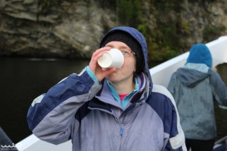 The boat went under a waterfall so people could drink the water. Here's Jessica taking her big gulp. The water is pure but very brown because of tannins it gains as it filters through the roots of the trees.