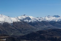 The zig-zagging path on the lower left is the road up to Treble Cone, which is a major skiing site.