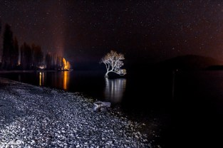 We went back down That Wanaka Tree at night to take more star/long exposure pictures. To illuminate the tree, we had Jessica flash our flashlight for a few seconds during the exposure. We think someone had a fire down the beach, hench the orange light in the background.