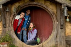 Three hobbit siblings in a hobbit hole. This was the only hole that you were allowed to go inside. Our nice tour guide Kieran took the photo for us. A nice summary of our trip--the cherry on top!
