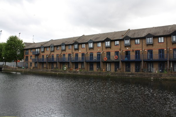 Brown terrace houses along the Thames River in London