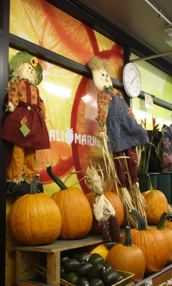 Pumpkin and scarecrow Halloween storefront decorations