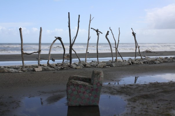 Hokitika - Driftwood sign on the beach - plus couch