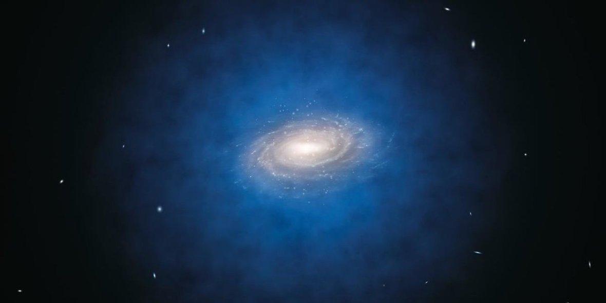 Слика 1. Уметничка илустрација на галаксијa во хало од темна материја. ИЗВОР: ESO\L