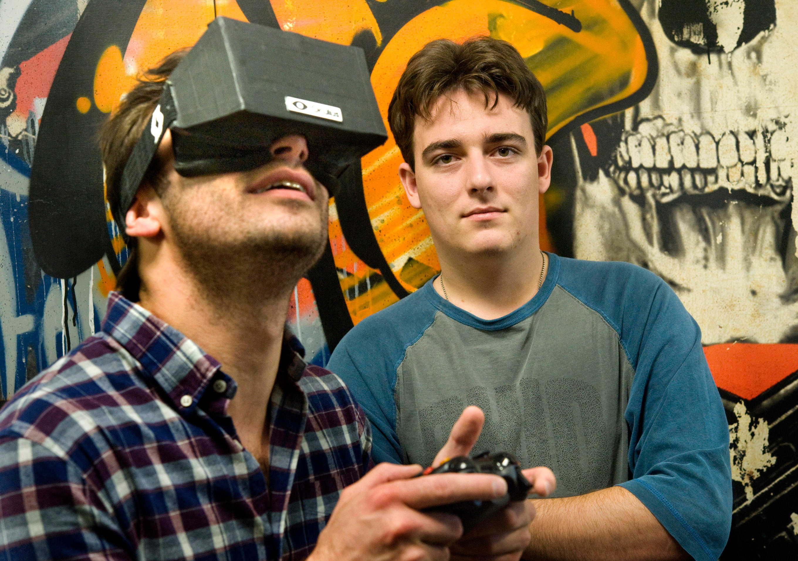 Nov. 14, 2011 - Irvine, California, U.S. - Oculus VR founder Palmer Luckey, 20, right, is the inventor of a virtual reality gami