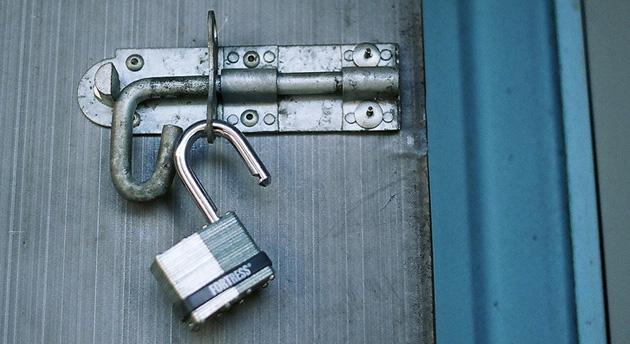 Open padlock on a door