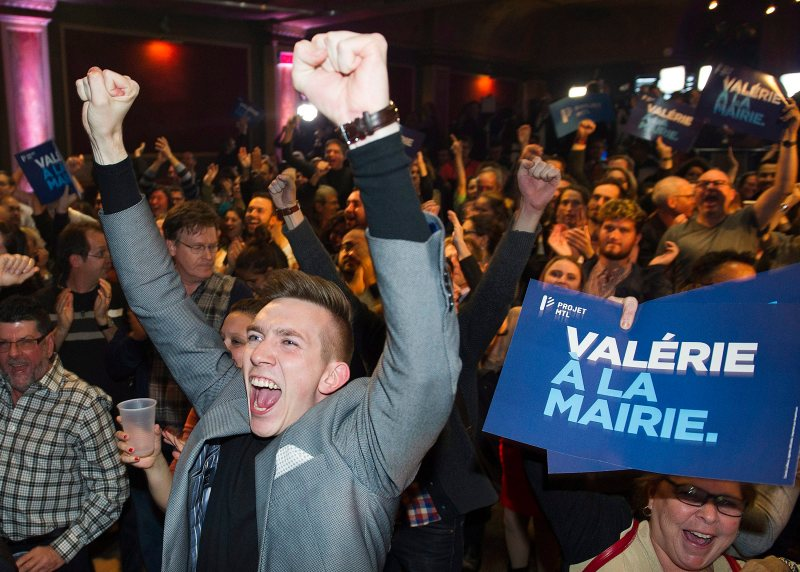 Valerie Plante's supporters react as votes comes in projecting her win on election night during the municipal election in Montreal on Sunday.