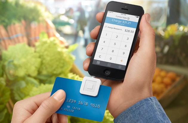 Taking a payment on a Square Reader attached to an iPhone