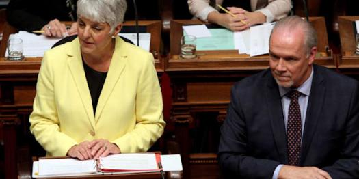 B.C. Finance Minister Carole James delivers the budget as Premier John Horgan looks on from the legislative assembly at Legislature in Victoria on Monday.