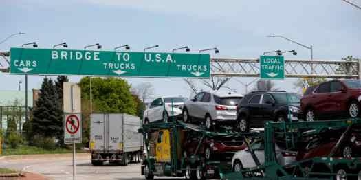 A car hauler heading for Detroit, Michigan, drives on the lane to Ambassador Bridge in Windsor, Ontario, Canada, April 28, 2017.