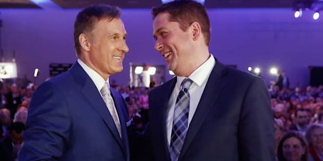 Maxime Bernier speaks with Andrew Scheer after the first results are announced during the Conservative Party of Canada leadership convention in Toronto on May 27, 2017.