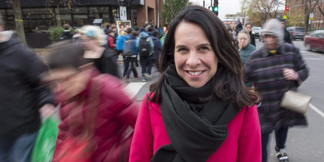 Montreal mayor-elect Valerie Plante stands on a busy street corner on Wednesday in Montreal.