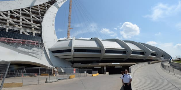A security guard stands outside Olympic Stadium in Montreal on Wednesday.
