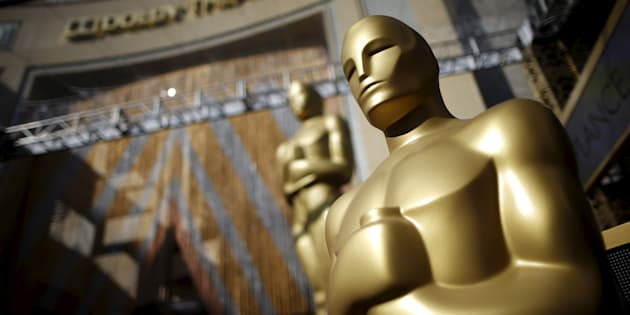 Oscar statues stand at the entrance to the Dolby Theatre as preparations continue for the 88th Academy Awards in Hollywood on Feb. 27, 2016.