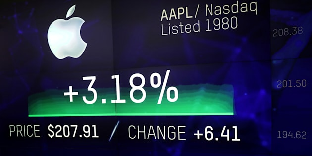 An electronic screen displays the Apple Inc. stock price at the Nasdaq Market Site in New York City, New York, U.S., August 2, 2018. REUTERS/Mike Segar