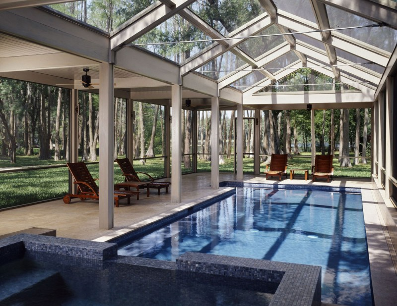 pool with windows surrounded by trees